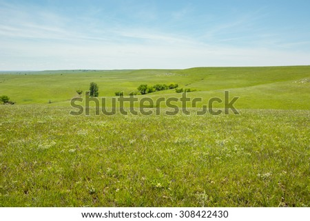 Rolling hills of the Kansas Flint Hills. - stock photo