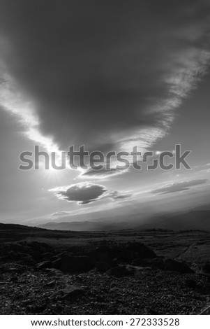 Rolling lenticular cloud formation over Mount Washington, New Hampshire in black and white monochrome. - stock photo
