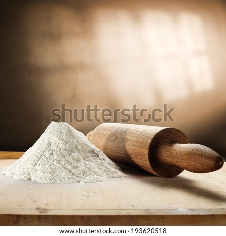 rolling pin flour and window shadow  - stock photo