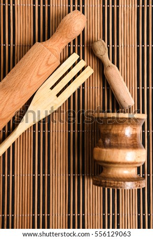 Rolling pin, wooden fork and mortar and pestle
