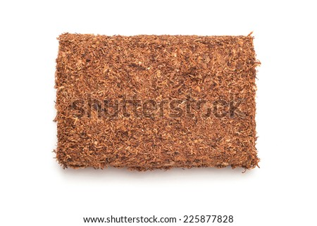 rolling pipe tobacco on white - stock photo