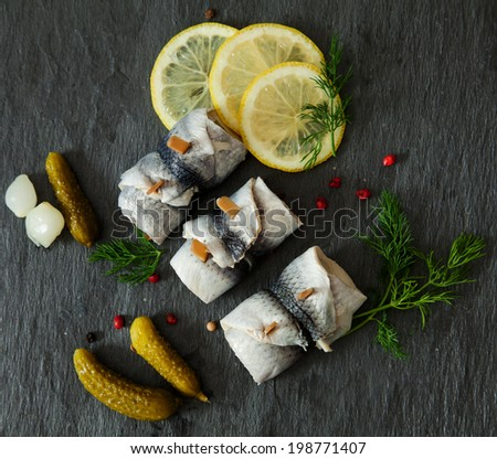 Rollmops - pickled herring fillets with lemon