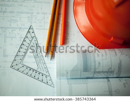 Rolls construction plans on a desktop of the architect