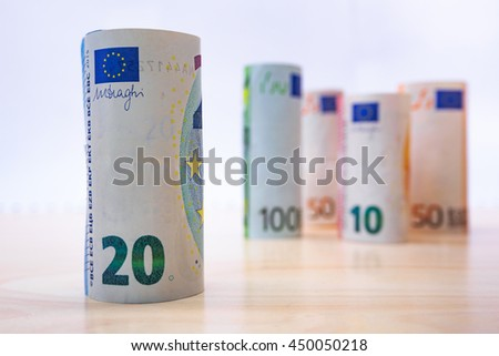 Rolls Euro banknotes. Euro currency money. Banknotes stacked on each other in different positions  - stock photo