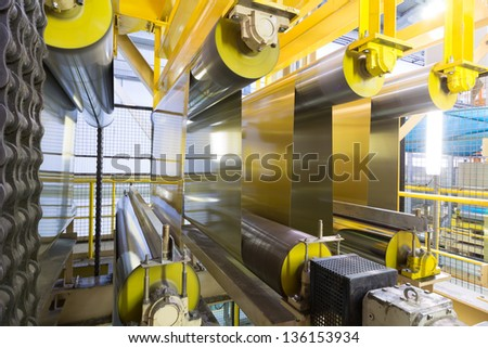 Rolls of aluminum extend on special machines of rolling mill - stock photo