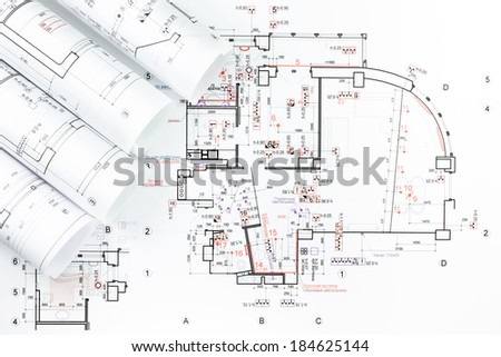 Rolls of architectural house floor plans with blueprint - stock photo