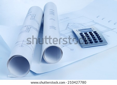 rolls of architecture blueprint, house plane & metric folding ruler - stock photo