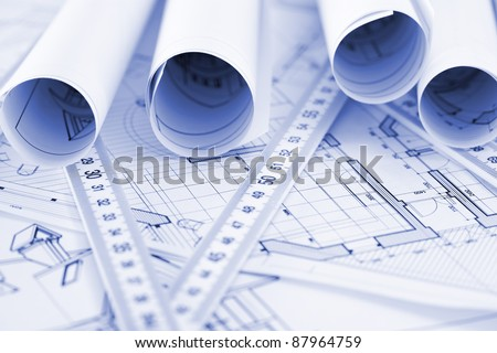 rolls of architecture blueprint, house plane & metric folding ruler
