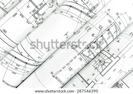 rolls of architecture blueprints and technical drawings, architectural background - stock photo