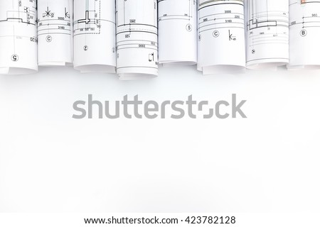 rolls of architecture blueprints and technical drawings on white background