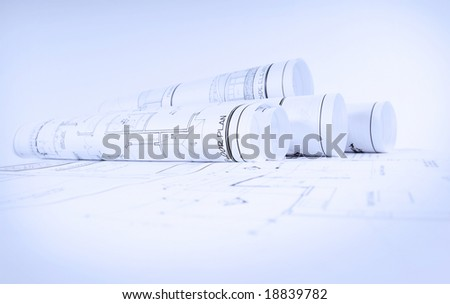 Rolls of blueprints for house construction - stock photo