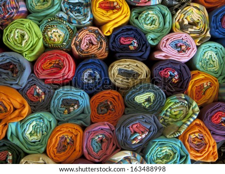 Rolls of brightly colored Fabrics / African Fabrics