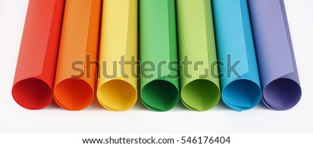 Rolls of colored construction paper on white background