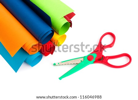Rolls of colored paper and scissors