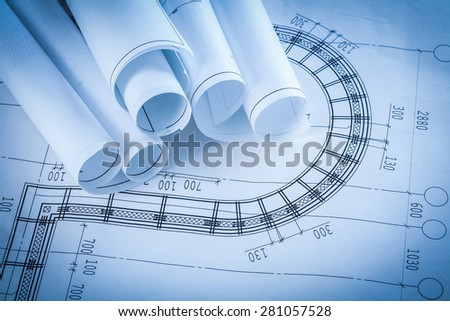 Rolls of construction blueprints building and architecture concept  - stock photo