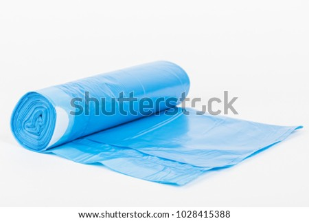 Rolls of disposable trash bags isolated on white background