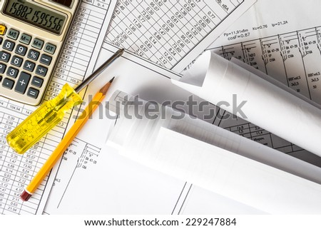 Rolls of drawings and tools for sketching and repair - stock photo