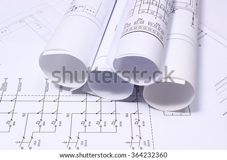Electrical blueprint imgenes pagas y sin cargo y vectores en stock rolls of electrical diagrams on construction drawing drawings for the projects engineer jobs malvernweather Image collections