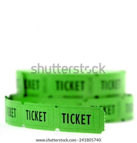Rolls of Green tickets connected together for admission  - stock photo