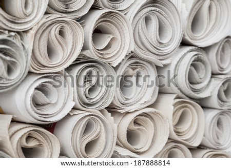 Rolls of newspapers, closeup shot. Breaking news, journalism, power of the media, newspaper and magazine ads and subscription concept. Great as a web page banner, article illustration and more. - stock photo