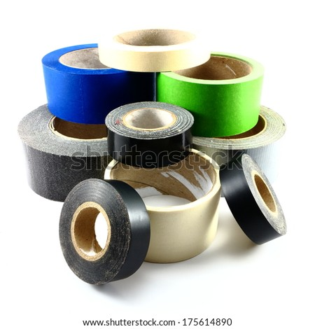 Rolls of old and used tape on white background - stock photo