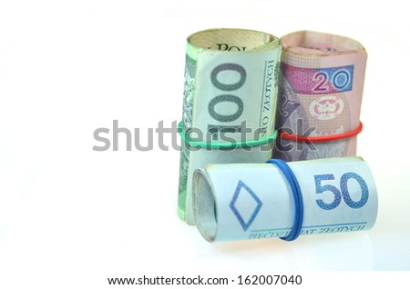 rolls of polish banknotes isolated on white - stock photo