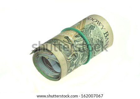 rolls of polish banknotes isolated on white