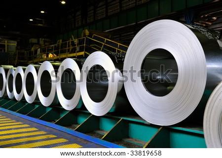 rolls of steel sheet in a warehouse - stock photo