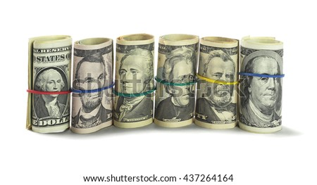 Rolls of US Dollars Standing on White Background - stock photo