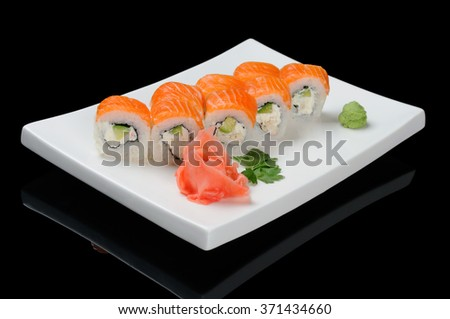 Rolls on white plate over black background - stock photo