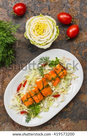 Rolls saute carrots, cream cheese, garlic and mayonnaise. wood background