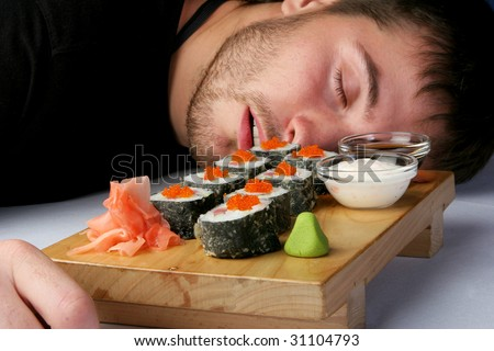 Rolls with salmon and octopus in black squared man sleeps, poisoned, badly, tastelessly - stock photo