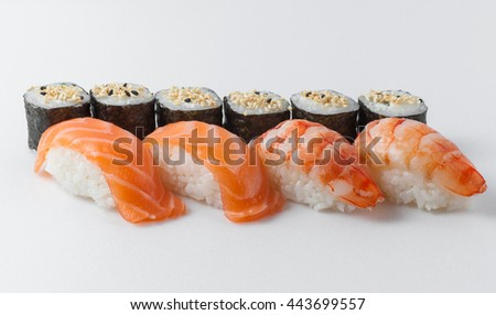 Rolls with sesame seeds and sushi with salmon and shrimps
