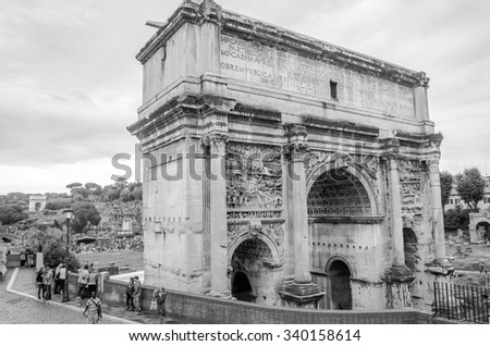 Roma, Italy - October 2015: Tourists walk and take pictures in the photo on the tour of the ancient ruins of the ancient imperial capital of the Roman Forum and Arch of Septimus Severus in Rome, Italy