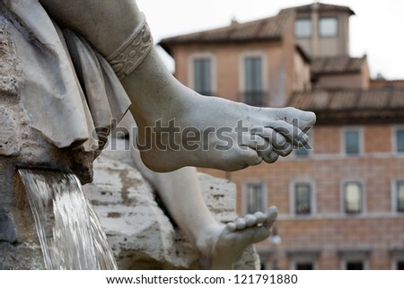 Roma - Piazza Navona square, Italy. Detail of the Fountain of the Four Rivers, showing of the river-god Ganges. - stock photo