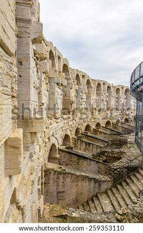 Roman amphitheatre in Arles - UNESCO world heritage in France - stock photo