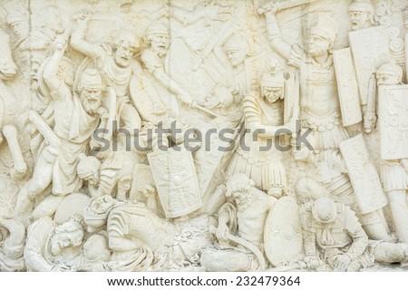 Roman And Dacian War Fight Scene On A Relief Of The Carolina White Fortress Of Alba Iulia In Romania Built In 1739 - stock photo
