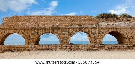 Roman aqueduct in Caesarea, Israel - stock photo