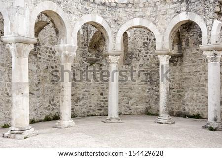 Roman arches in the town Rab on the island Rab in Croatia - stock photo