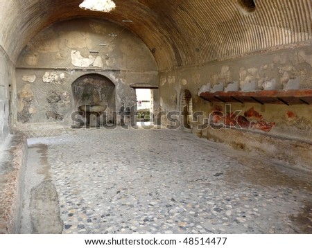 Roman baths at the ancient city of Herculaneum, which was destroyed and buried by ash during the eruption of Mount Vesuvius in 79 AD - stock photo