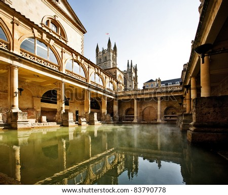 Roman Baths with Bath Abbey reflection in Bath, England - stock photo