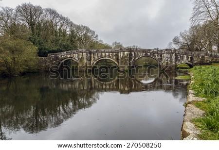 Roman bridge in Brandomil, Camino de Santiago, A Galicia, Spain - stock photo
