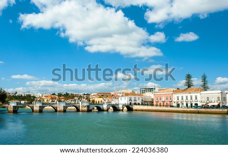 Roman bridge in Tavira, Algarve, Portugal - stock photo
