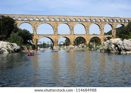 Roman bridge of Pont du Gard over river Gard on France