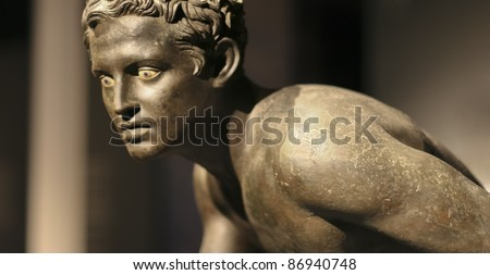 Roman bronze statue of a runner - Excavated at Herculaneum near Pompejii. Both cities near Naples in Italy were destroyed by the eruption of Vesuvius in 79AD. - stock photo