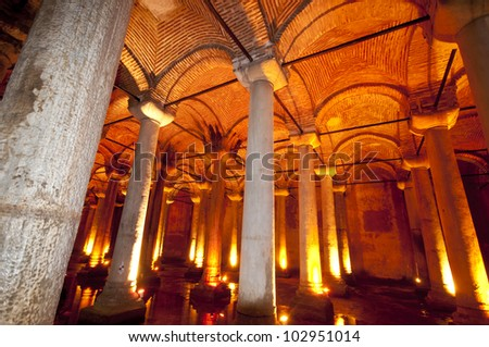 Roman Cistern Basilica in Istanbul with dramatic stone columns, water and a brick domed roof.  Illuminated from below. - stock photo