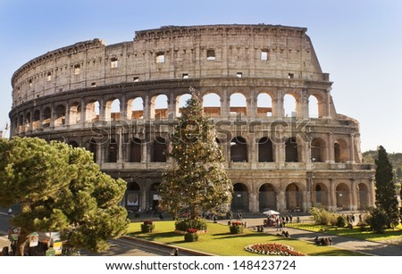Roman Coliseum celebrates Christmas, view of the Colosseum and of its Christmas tree, Rome, Italy - stock photo