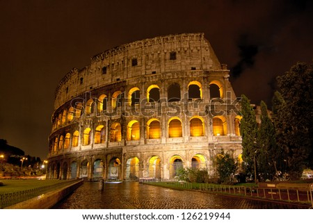 Roman Colosseum by night - stock photo