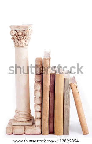 Roman column bookend and old books isolated in a white background