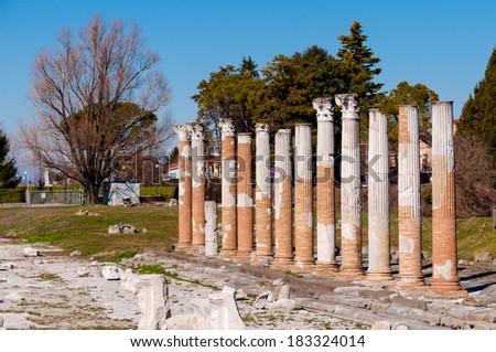 Roman columns on Aquileia archeological area in Italy - stock photo